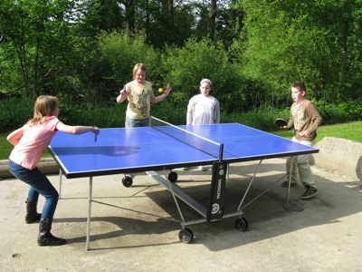 English family playing table tennis